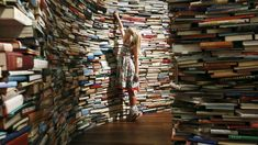 Leona, poses inside a labyrinth installation made up of books titled 'aMAZEme' by Marcos Saboya and Gualter Pupo at the Royal Festival Hall in central London July REUTERS-Olivia Harris Books To Buy, I Love Books, Great Books, Books To Read, Amazing Books, Children's Books, Pierre Richard, How To Read More, Spiegel Online
