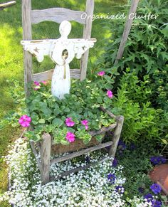 Garden art ladder, birdhouse, and wooden daisy with perennials and annuals make a beautiful border.