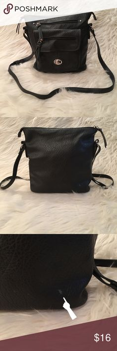 Cute Black Bucket Cross Body Purse - Gently Used Cute Black Bucket Cross Body Purse - Gently Used - has small defect that can be seen in pic #3. - Measures 10in x 10in - Strap extends to 26in - and shortens to 14in - has 3 outside pockets & 2 more inside. Bags Shoulder Bags
