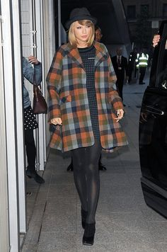 Taylor's colorful, plaid Novis coat would definitely stand out in a sea of black and gray outerwear.