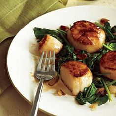 --Made this last night and it was a real crowd pleaser! -- Pan-Seared Scallops with Bacon and Spinach | MyRecipes.com