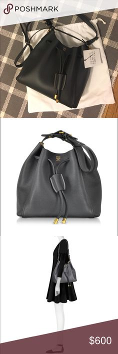 "MCM Milla Drawstring Bucket Bag NWT MCM ""Milla"" bag in pebble-grain cowhide leather. Phantom Gray Color.  Shoulder straps with screwhead detail and adjustable prongs. Drawstring top with aglet detail. Inside, suede/Visetos lining; open pocket. Approx. 13""H x 11.4""W x 9.5""D. Individually numbered plate details every MCM product. MCM Bags"