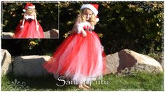Girl wearing red and white Santa tutu dress. Santa little helper ;-)
