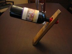 Gravity defying wine bottle holder
