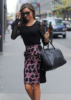 Miranda Kerr with a simple black top with graphical patterned skirt.