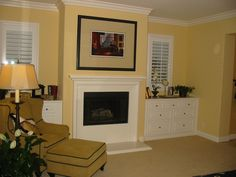 Fireplace with built in dressers....needs shelves too! (Which wall? One without windows?)