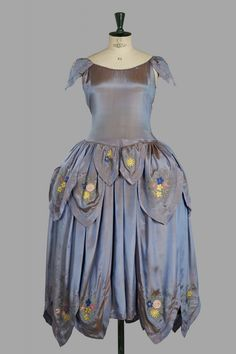 Robe de Style, Jeanne Lanvin: ca. 1922-1923, shot silk embellished with tamboured roses and other flowers, the tiers trimmed with floral lappets.
