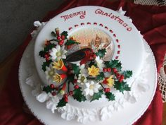 Christmas cake with fondant holly, christmas bells, flax, first attempt at smocking and garret frill