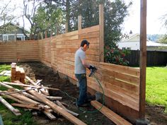 horizontal fence - this is a neat twist on the usual vertical fence and can make your smaller yard look bigger.