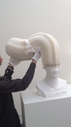 Li Hongbo demonstrating how his paper sculptures work.