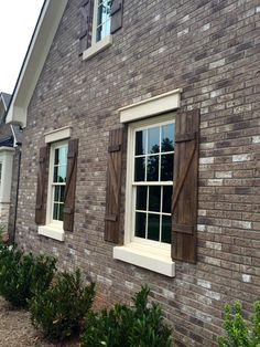 ARH Plan Castleberry (Exterior 34) Brick = Boral Savannah Gray with gray mortar, Shutters = Chestnut SW3524, Roof = Oakridge Driftwood, Soffits & Fascia = Canvas Tan SW7531, Stone = Coronado Stone Country Rubble Texas Cream, Stucco = #611 Flax, Metal Roof (Outdoor Wood Shutters)