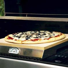 PizzaCraft Grill Stone With Built-In Thermometer available at BBQ Guys. The crispy crust and bubbling topping of brick-oven pizzas is as...