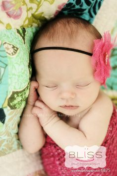 Now here's a baby pic that's sweet and cute and doesn't have some newborn stuffed in a flower pot or hanging from a tree. I like this.
