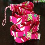http://www.allthingsgd.com/2013/12/diy-ornaments-made-from-wrapping-paper-scraps/