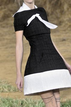 Chanel - love the dress and texture but the handkerchief can go.