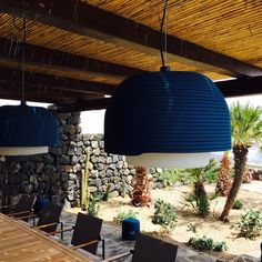 Outdoor dining tables  Outdoor pendant lighting  By Andrea Angelini