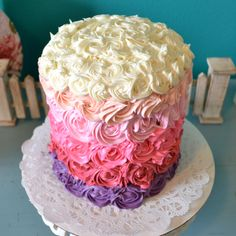 "6 layer ""Princess"" flavored rosette cake - too many shade gradations. Also, I think roses would look better off-set from row to row."