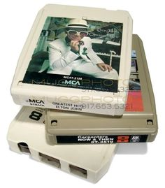 Eight-track tapes.  My father had an 8-track player in his Blazer in the 1970s.  The carrying cases for the tapes were like luggage.