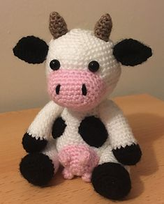 This is Claire the Cow. She is part of a collection of farm animals. She has horns which are usually removed from female cows, this makes her unique.