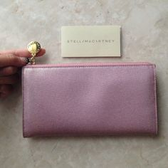 HP✨ Stella McCartney Pink/Gold Shimmer Wallet✨ ✨ Authentic Stella McCartney Pink/Gold Shimmer Zip Around Wallet in excellent condition. Used only a handful of times. Two bill slots - one on each side, 8 credit card slots, 1 center zip compartment, and a back slot receipt compartment. Beautiful iridescent pink with gold hardware. This is a epic girly wallet.✨ Stella McCartney Bags Wallets