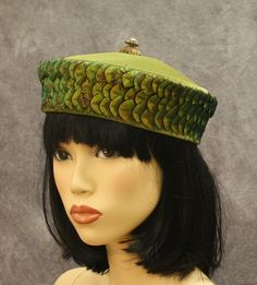 Cossack-style hat of olive green velvet with peacock feather c.1930 with label: Custom Made/ Lulu Margarette/ San Francisco.