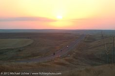 Mike Wild of England aat sunrise on his 1924 Rudge getting near the Badlands. Motorcycle Cannonball II pre-1930 Coast-to-Coast Endurance Run. Stage 7 - Murdo, SD to Sturgis, SD. USA. September 13, 2012. Photography ©2012 Michael Lichter.