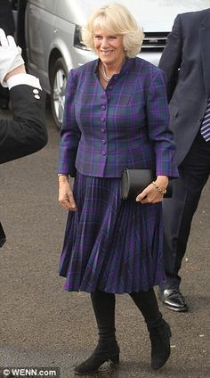 Camilla, Duchess of Cornwall wearing tartan Edina Ronay during their visit to Ebony Horse Club And Community Riding Centre, Brixton on in London, England. Camilla Duchess Of Cornwall, Duchess Of Cambridge, Brixton, Fashion Fail, Women's Fashion, Prince Charles And Camilla, Camilla Parker Bowles, Hm The Queen, Funny Outfits