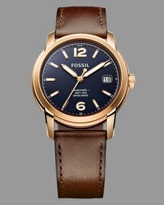 It's a Swiss-made automatic for under $1000, which is more than enough to sell us on this dressed-up timepiece from Fossil. But what really got us what that rose gold-colored casing set off by the navy dial. Swiss-made automatic watch ($995) by Fossil, fossil.com