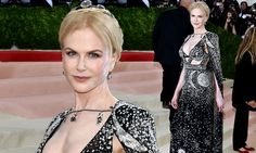 The 48-year-old Hollywood star turned heads on the red carpet in a dazzling plunging black sorceress-inspired gown and cape.
