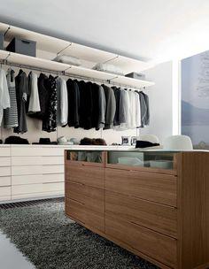 Nicchia by Fimes: bifacial chest of drawers in Canaletto walnut and walking closet in Seta . #bed #nightstand #bedroom #closet #slidingdoors #leafdoors #interiordesign #design #modern #contemporary #madeinitaly #salonedelmobile #fieradelmobile #isaloni #fieramilano #luxury #glamour #artdeco #fimes #dresser #tvunit #sofa #mirror #silver #gold #leather #glossy #swarovski #fimeshomedesign #homedesign #clay #bookcase #walkingcloset #cornerbed #coplanar #leather