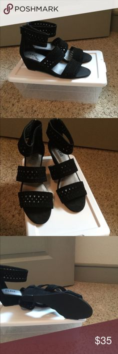 Reba black leather Sandals. Reba black leather high heel sandals. These  leather sandals are in excellent condition. Worn once. Closed back with zipper. Reba Shoes Sandals