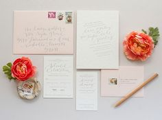 The calligraphy is in pale gray ink, but the lacy floral design around the border of the invite is an impression, rather than an in-your-face illustration. | See more spring #wedding invitations here: http://www.mywedding.com/articles/spring-wedding-invitations/