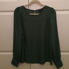 New J Crew Blouse in Hunter Green New, never worn,  J Crew blouse in hunter green size small. Buttoned cuffs, slightly puffy sleeves, and a keyhole at the back of the neck make this blouse look amazing! Note: there is a slight mark on the front as seen in picture 2-it is so barely noticeable (exaggerated by flash so I could make it visible in a picture), just noting for completeness sake. Top is machine washable, and I'm sure some Dawn will do the trick! J. Crew Tops Blouses