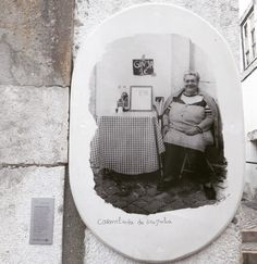 """Mrs. Carmelinda proudly poses with her sour cherry liquor (known as Ginjinha). Throughout the Alfama quarter, beyond meeting the locals, you'll find beautiful portraits of British photographer Camilla Watson depicting some of the local """"celebrities"""". #alfama #meetthelocals #thelocalcelebrities #tradition #heritage #photography #camillawatson #lisbon #lisbontailoredtours #lisbonwithpats"""