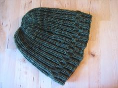 Malabrigo beanies are the popular topper in our house. With the holidays arriving, this hat knits up quickly, leaving you plenty of time for cookie consumption. Or enough time to make another, since your boyfriend wants to keep the first!