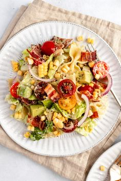 Damn good BLT pasta salad made with fresh corn, tomatoes, romaine lettuce, creamy avocado and crispy bacon. This easy, healthy BLT pasta salad recipe is tossed in an incredible, creamy jalapeño cashew dressing for an unbelievably delicious twist on your favorite sandwich. Perfect for potlucks, BBQ's or enjoying for a healthy lunch or dinner! #blt #pasta #pastasalad #cashews #bacon #saladrecipe #potluck #bbq #picnic #glutenfree #dairyfree #lunch #dinner #mealprep #avocado #summerrecipe