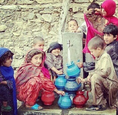 Afghans - Fetching water.