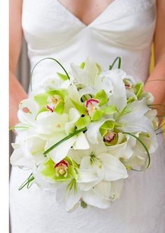 This bouquet of ivory lilies, lime green orchids and bear grass is stylish and fun!