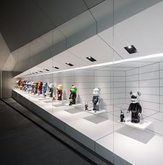 Bear Garage by Open Box and Onion Studio | each be@rbrick figure stands on floating white platforms