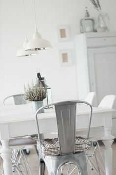 kitchen. Tolix, dining table, industrial pendants, white wash.