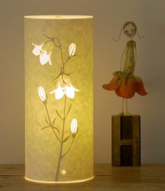 H is for Harebell. lamp is shown here with a sculpture by Edwina Bridgeman