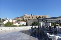 Grab some nosh and a drink at the Acropolis Museum cafe and enjoy the view in the shade.