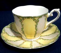 Rare Royal Albert Bone China Rococo Yellow with Green Tea Cup and + Saucer Set Tea Cup Set, Cup And Saucer Set, Tea Cup Saucer, Green Tea Cups, Yellow Cups, Teapots And Cups, Teacups, Tea Sets Vintage, China Tea Sets