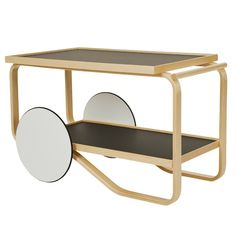 Artek Alvar Aalto Tea Trolley 901 Designed by Alvar Aalto in this tea cart brings glamour back to teatime. Beautiful birch wood provides the framework for the cart while white laminate or black linoleum add a chic surface to the . Alvar Aalto, Table Furniture, Cool Furniture, Modern Furniture, Furniture Design, Inexpensive Furniture, Furniture Ideas, Tea Trolley, Tea Cart