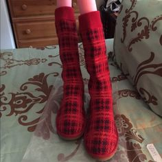 Genuine UGG plaid and leather tall boots These are genuine UGG suede and plaid tall boots. Pretty red and black plaid and suede tall boots. Picture of tag inside to show proof of authenticity.  They are size 9 medium width. These have been worn twice. No damage no stains no wear. The top can be cuffed. The boots reach below the knee. I will ignore ALL TRADE REQUESTS and LOWBALLS. UGG Shoes Winter & Rain Boots
