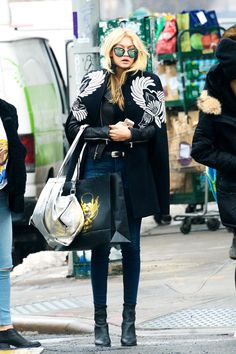 Gigi Hadid was photographed in New York City wearing a Stella McCartney cape, skinny jeans, ankle boots, and a silver knapsack that could be spotted from a mile away (um, kind of like her legs)