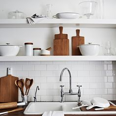 Sainsbury's has launched this pared-back collection of kitchenware: white cast-iron pans, wooden chopping boards and utensils, and cylindrical storage containers in ceramic and oak