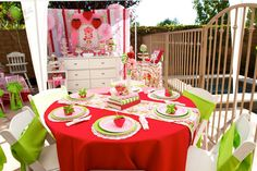 Pretty table setting at a Strawberry Short Cake Birthday Party