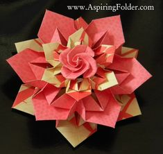 """This beautiful origami rose ornament is perfect to make for a gift or as a decoration for your home. Each """"layer"""" or wreath uses 6 pieces of paper, and there are three layers, not counting the rose..."""