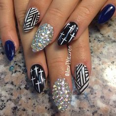 Cross images painted on ugly stiletto nails